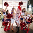 8 Event chairs Maneesh Singal, left, and Paul Pettie with Texans cheerleaders at the Bering Omega Toga Party July 2014