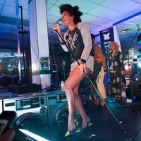 Solange Knowles performs on dryer at vitaminwater and THE FADER uncapped in Brooklyn laundry mat