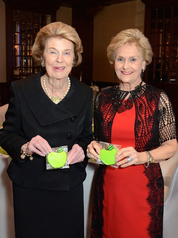 9 Patricia Reckling Taylor, left, and Annette Dewalch Strake at the Houston Food Bank dinner April 2014