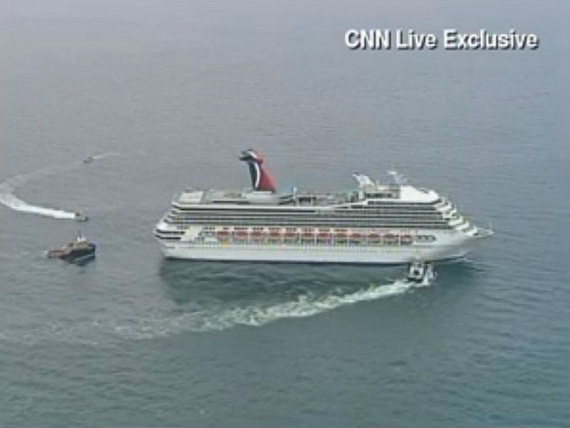 Carnival Triumph, being towed to Mobile