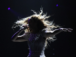 Beyonce in shadow with hair flying