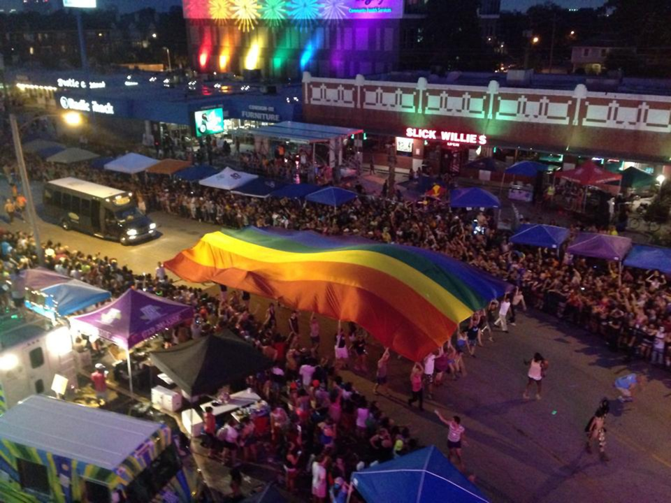 Pride Houston parade rainbow flag at night from above June 2014