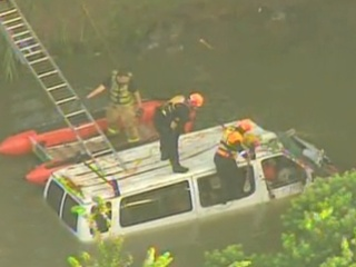 Van crashes into Bayou and all seven survive.