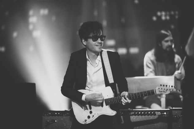 Phoenix guitarist in glasses