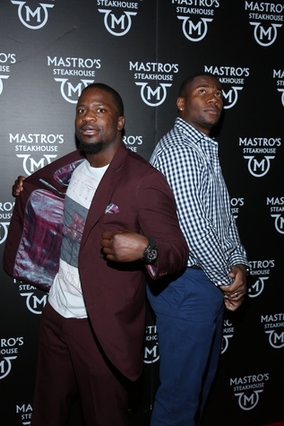 11 Jameel McClain, left,  and Daniel Fells at the opening of Mastro's Steakhouse in NYC November 2014