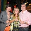 Evgeny Krasilnikov, left, with Kate and Chris Hutson at the Q The Salon Moroccan theme party September 2013