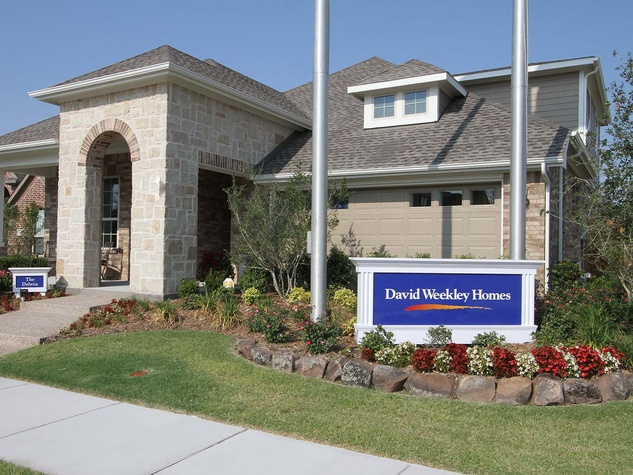 David Weekly Homes Houston real estate company sign in front of house