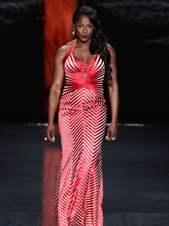Actress Rutina Wesley, wearing Max Azria, walks the runway at Go Red For Women - The Heart Truth Red Dress Collection 2014 Show February 2014