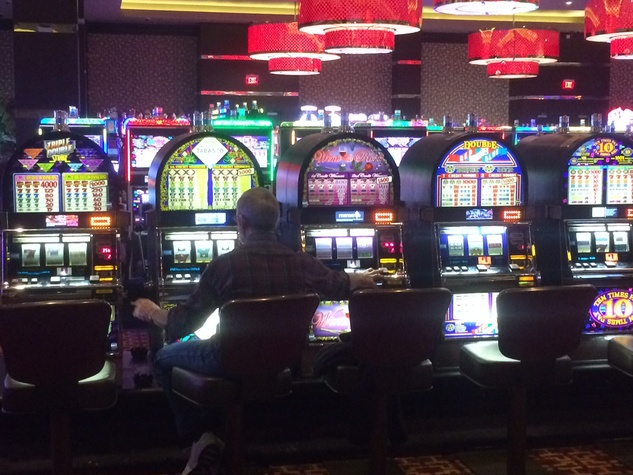 Guy plays three slot machines at Golden Nugget in Lake Charles