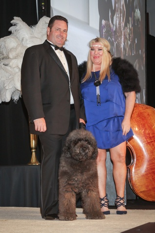 Brent Milam, Lara Bell with Outback at CAP Gala