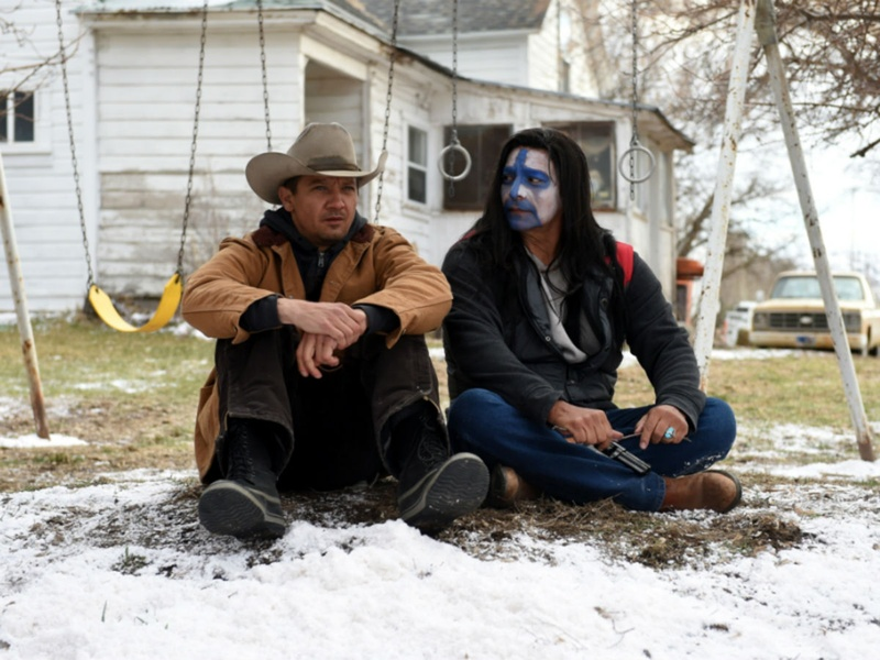 Jeremy Renner and Gil Birmingham in Wind River