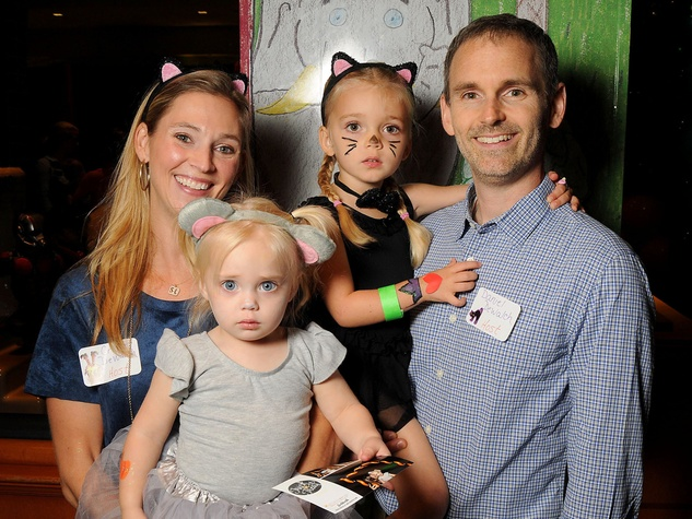 MD Anderson Halloween at the Galleria Cricket and Daniel DeWalch with Sophie, 3, and Lauren, 2