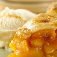 peach pie slice with ice cream
