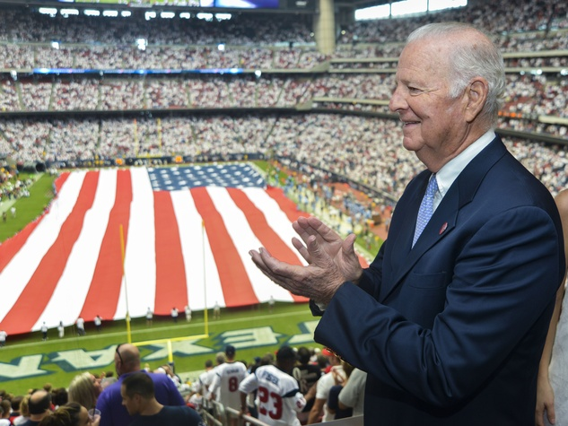 7 Texans owner's suite home opening game September 2013 James Baker and American flag on field at Reliant Stadium