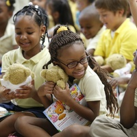 Atherton Elementary School students receive book and teddy bear from John Moore