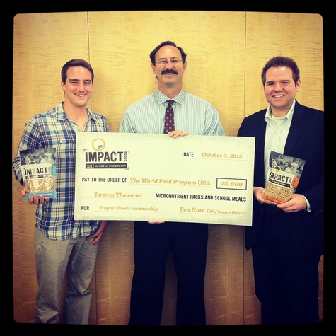Impact Foods founders Ben Hurt and Blaine Iler delivering a check to the World Food Program