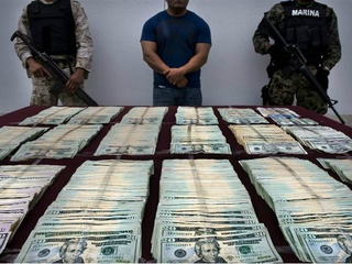 Money and guns seized from Mexican drug cartel