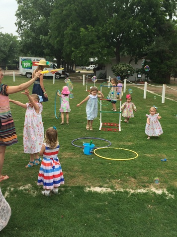 Children playing at the Yellowstone Academy polo party April 2014