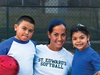 Cat Osterman with kids from RBI nonprofit