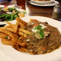 Carbonnade au flamande with frites and salad Saint Arnold Brewing Company lunch