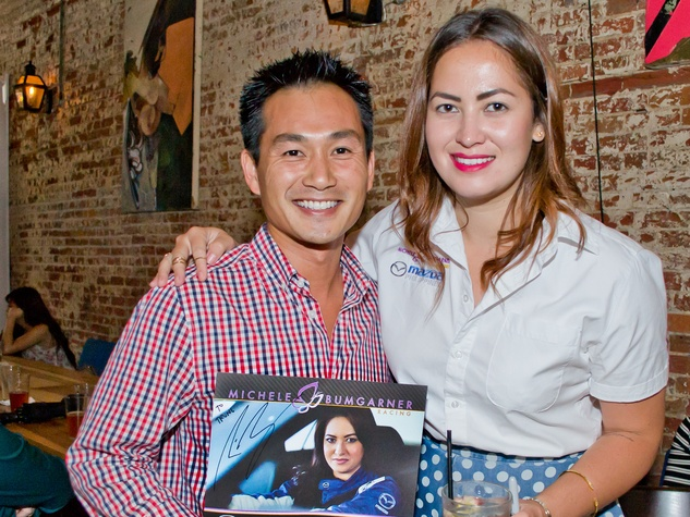 15 Trung Huynh and Michele Bumgarner at the Young Professionals Grand Prix kick-off party June 2014