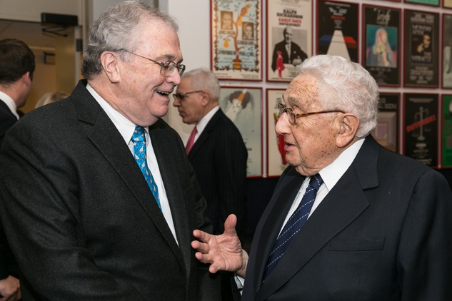 Tom Johnson, left, and Henry Kissinger