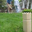 News_Kubb_people playing_lawn game