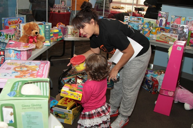 18 A patient picks out a toy at the holiday party at Santa visits Texas Children's Cancer Center December 2014