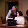 "Emily Scott Banks and John S. Davies communicate in ""Ghost-Writer"" at Circle Theatre in Fort Worth."