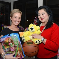 19 Brenda Koch, left, and Gigi Huang at Joyful Toyful December 2014