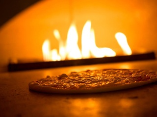 il Mascalzone pizza in wood-burning pizza oven London