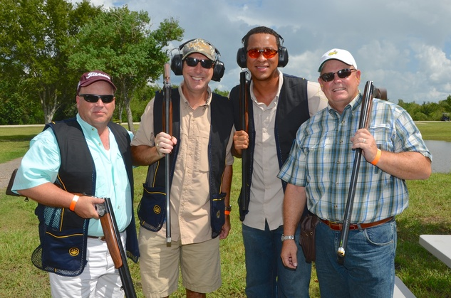58 Robert Reed, from left, Derryl Cleveland, Peter Goebel and Bo Luzey at the Backpack Buddies sport shooting event September 2014