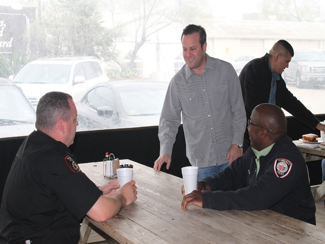 Levi Goode with Houston firefighters