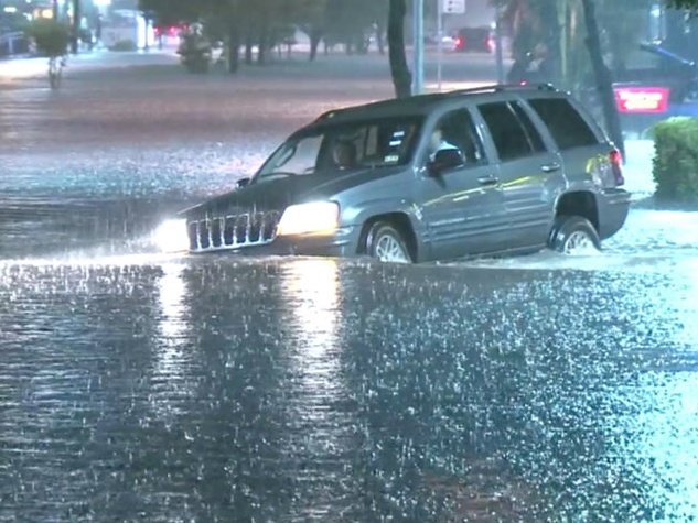 Dozens of vehicles were flooded on Bellfort Avenue as severe storms moved through the Houston area flooding