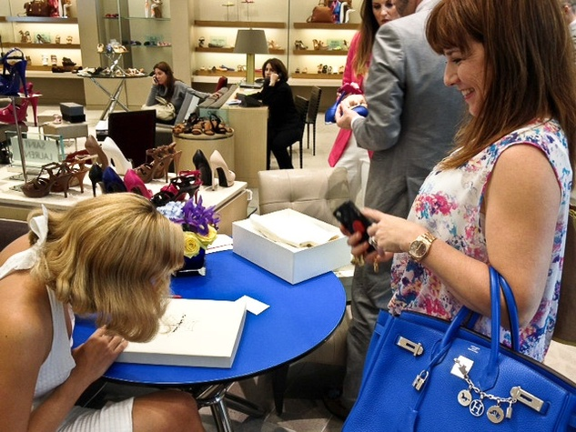 4 Charlotte Olympia shoe designer April 2013Charlotte autographing shoes for Donae Chramosta