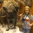 Kendall Jones with buffalo at hunting convention August 2014