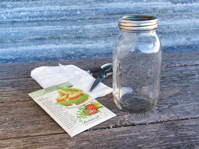 Mason jar, scissors and cheesecloth