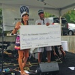 Big check presented at hula hut party for Tyler's Dam that Cancer