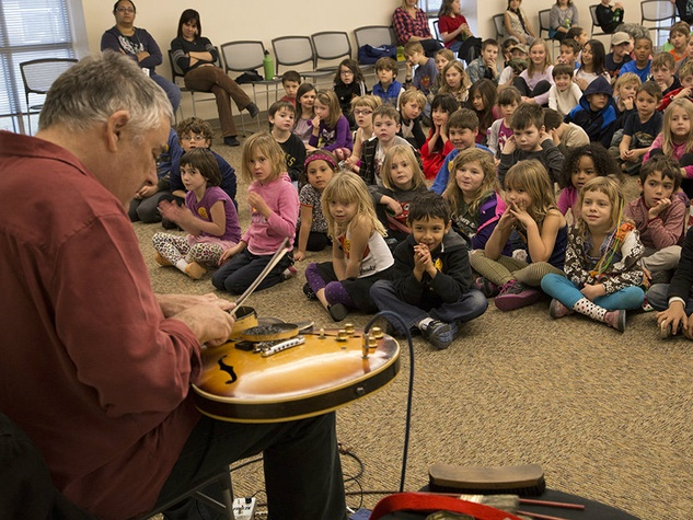 Fred Frith performing in front of school children