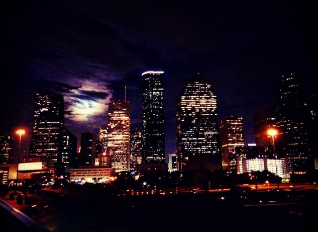 "1 Supermoon over downtown Houston August 2014 ""The super moon rises over downtown Houston. """