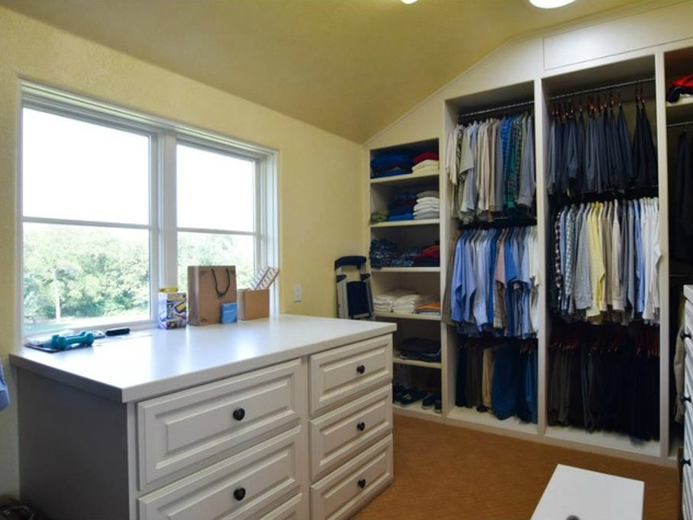 Master closet at 12258 Creek Forest Dr. in Dallas
