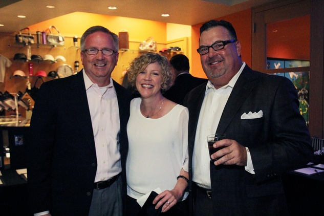 9 James and Deborah Harris, from left, with  Jim Kole at the Mercedes-Benz of Sugar Land Cystic Fibrosis Event October 2014