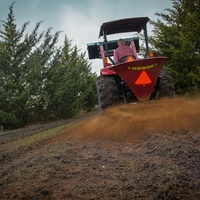 Soil amendments being applied to farmland.