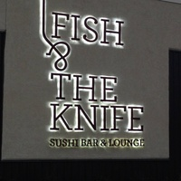 Fish & The Knife Sushi Bar & Lounge sign at night