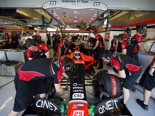 Austin Photo: Kevin_Marussia sponsor Formula 1_November 2012_team garage