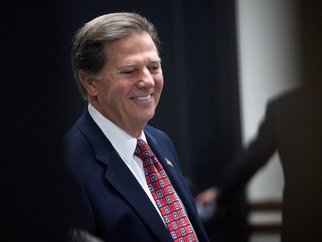 Tom DeLay smiling and wearing a suit 2011 photo