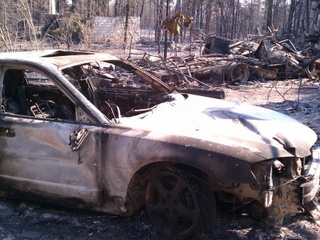 Austin Photo: News_Kevin Benz_KXAN Wildfires_August 2011_burned car