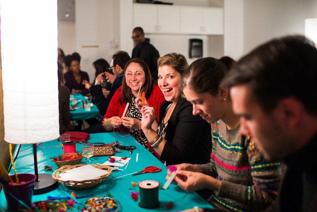 Guests at the craft table at the MFAH Art Crowd Party November 2014