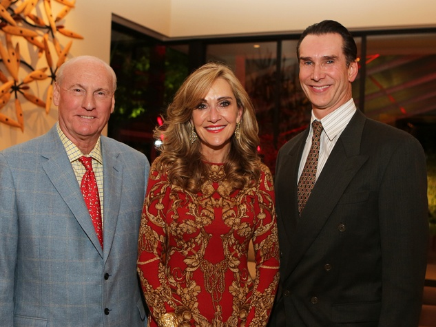 Scott and Jana Arnoldy, from left, with Todd Waite at the Alley Theatre Board Holiday Party December 2013