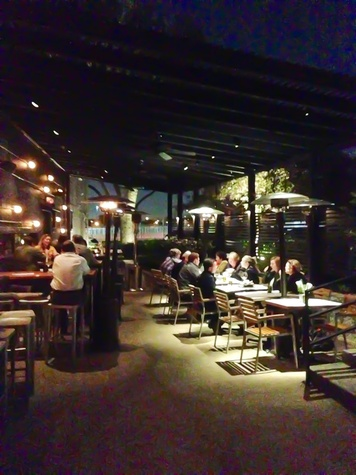 The Pass U0026 Provisions Patio At Night With People